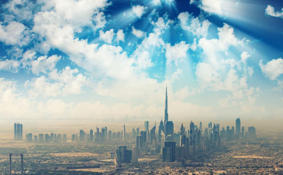 Sunshine Breaking Through The Clouds to Show The Skyline of Dubai and a Potential Sand Storm | The Vacation Builder