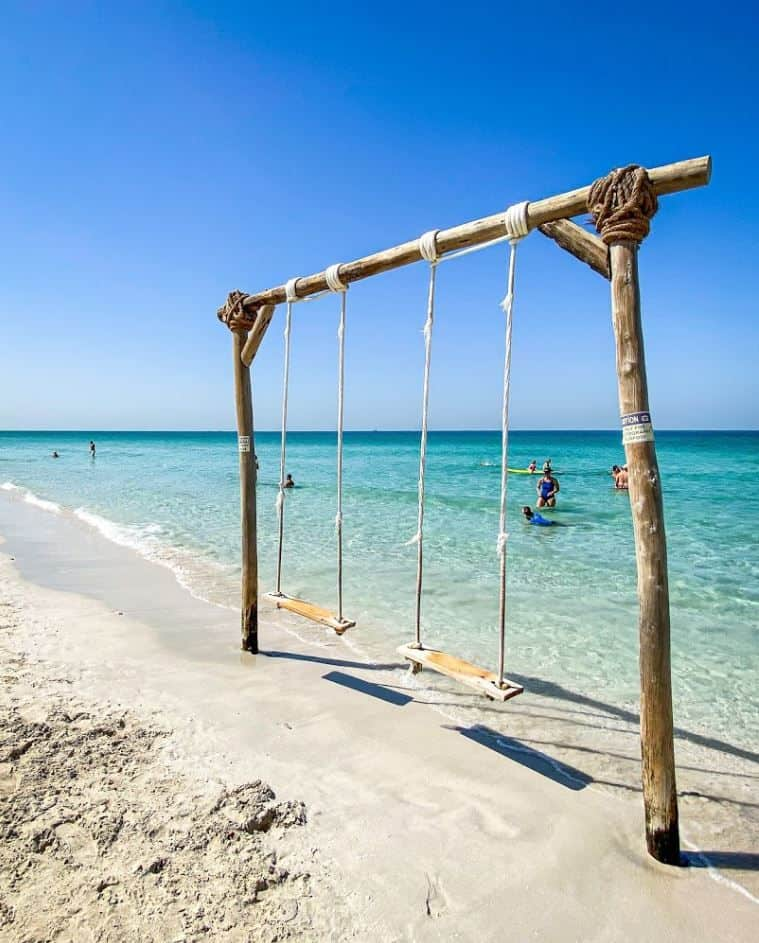 Things to do at Al Quwain Beach - Beach Swings | The Vacation Builder